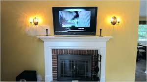 wall mount tv above fireplace mounting above fireplace large size of high to mount over in