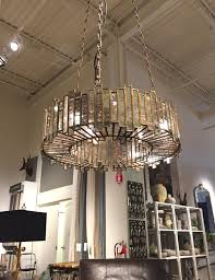 arhaus where the bulbs are cleverly concealed so that it would be pleasant to have it hang over a dining room table in the center of a room