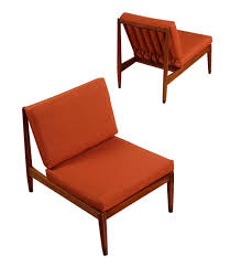 pair of red folke ohlsson for dux lounge chairs