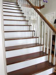 diy home improvement removing carpet on a staircase and staining the wood