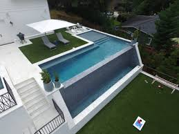 Negative edge pools Black Granite Inground Swimming Pool With Negative Edge Tile Edge Wall Artistic Pools Atlanta Pool Builder Custom Swimming Pool With Vanishing Edge
