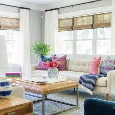 White Tufted Sofa With Pink And Blue Pillows