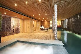 View in gallery Luxurious home spa with wooden furnished walls and  waterworks ...
