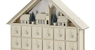 aldi launches 9 wooden advent calendar to rival near identical designer 65 one from harrods but which is which mirror