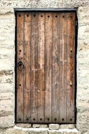 old castle doors ancient wooden door in old stone castle wall stock photo old castle doors