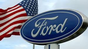 Superb An American Flag Waves Behind A Ford Sign At A Ford Dealership In San Bruno,