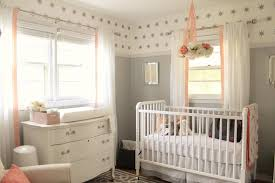 5 tips for creating a gorgeous grey nursery appropriate navy and pink crib bedding by thespruce com