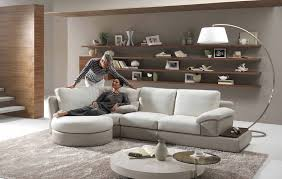 living room cozy minimalist room white lacquered wood sideboard black glass coffee table top leather