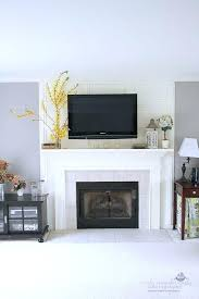 tv on fireplace mantel decorating a mantel with a above meadow lake road tv over fireplace mantel height