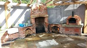 outdoor kitchen with pizza oven fireplace decorating