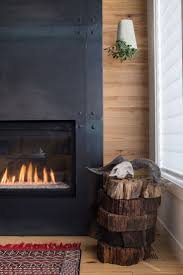 Modern fireplace + wood paneling for warmth