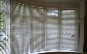 Window Blinds  Window Venetian Blinds Patterned Roman In A Bay Bay Window Vertical Blinds