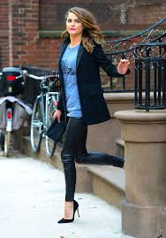 picture of leather leggings a printed tee a black jacket and suede heels