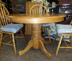 beautiful 42 diameter solid round oak pedestal table with four chairs all are in excellent condition with very few scratches if any includes 17 leaf