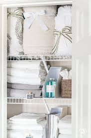 sheet organization in a tiny linen closet