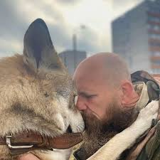 Man Rescues and Raises Wolf Cub, and Now They Are Inseparable