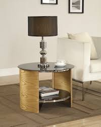 furniture round brown wooden bedside table with black glass top and single shelf on dark