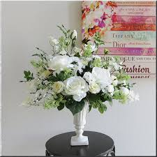 Large-flowered White Rose of lemon yellow and white. Draped in flowers and  Larkspur flowers flower arrangement. As a housewarming gift for mother's  day, ...