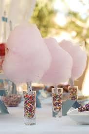 cotton candy for weddings. pink cotton candy centerpieces in shot glasses filled with sprinkles for weddings v