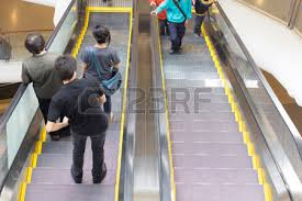 people on escalators. people in motion escalators at the modern shopping mall stock photo, picture and royalty free image. image 26479591. on