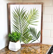 tropical palms are all the rage this year in home decor i have to admit i am kind of obsessed with them myself right now minimal framed wall art also is