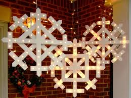 Outdoor Christmas Decorating How To Make Wooden Snowflakes With Lights How Tos Diy