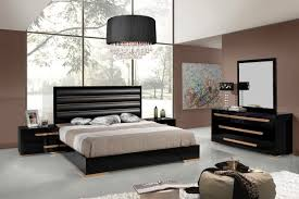 bedroom black wooden bed white marble floor glass table lamp brown bedding silver pillow chandelier