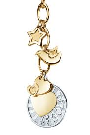 Turn your memories into pure gold with Tiffany Charms. | Tiffany ...