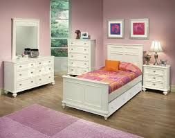 next childrens bedroom furniture. White Wooden Bed With Headboard And Trundle Next To Bedside Table Three Drawers Childrens Bedroom Furniture U