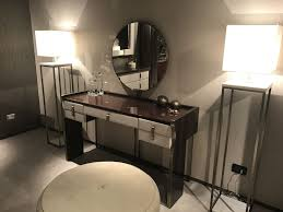 luxury dressing table with round mirror and gold accents