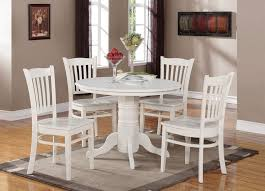 traditional white round kitchen table set with rug
