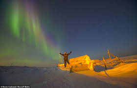 lighting up the sky stephen is pictured with the aurora borealis as the backdrop as