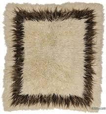 beige brown vintage turkish tulu rug