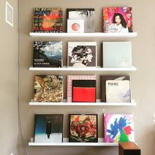 what if you want to show off your vinyl art try turning your collection outward on a series of shelves