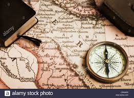 antique p with case book and old map concepts of exploration discovery adventure navigation direction monochrome sepi