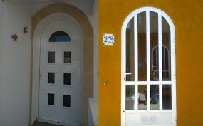 arched front door with glass inserts