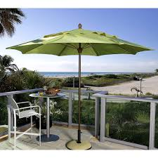 white striped patio umbrella: wrought iron high bar stools and green target