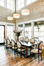 dining room designer furniture exclussive high:  farmhouse style dining room with high ceiling and glass windows design msa architecture