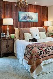 bedroom paneling ideas: contemporary white shade table lamp on walnut wood bedside table also bronze chandeliers in bedroom wooden wall paneling ideas for home interior decoration