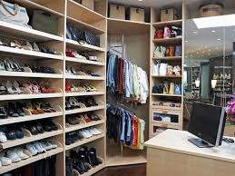 walk in closet with tie trays and pullout shoe racks