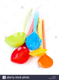 colorful kitchen utensils. Various Colorful Plastic Kitchen Utensils On White Background - Stock Image E