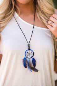 Dream a little dream with these miniature dreamcatcher necklaces. Adorned  with a small ceramic bead