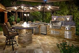 gallery outdoor kitchen lighting:  beautiful stacked stone siding custom backsplash accents and granite counter top