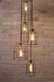 basement stairwell lighting. cage light chandelier 5 drop edison lightingstair lightingbasement basement stairwell lighting e