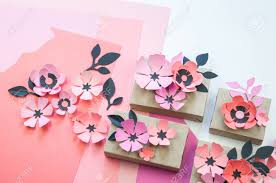 Flower Made In Paper Packing A Festive Box With Ribbons And Flowers Flower Made Of