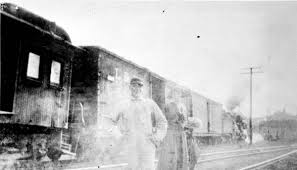Florida Memory • Ivan Leonard and Miss Marjorie Ward with engine number 8 -  Galliver, Florida