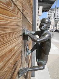 we don t have much info on him other than he s a piece of forged art but we re not sure we d want a door handle of a tiny man who looks like he s
