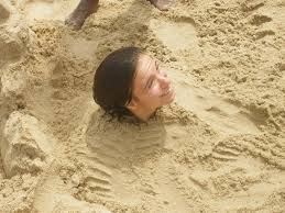 Girls buried in sand face fucked