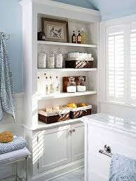 large built in shelving and cabinets for lots of extra bathroom storage