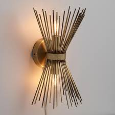 what is sconce lighting. brass starburst logan wall sconce what is lighting